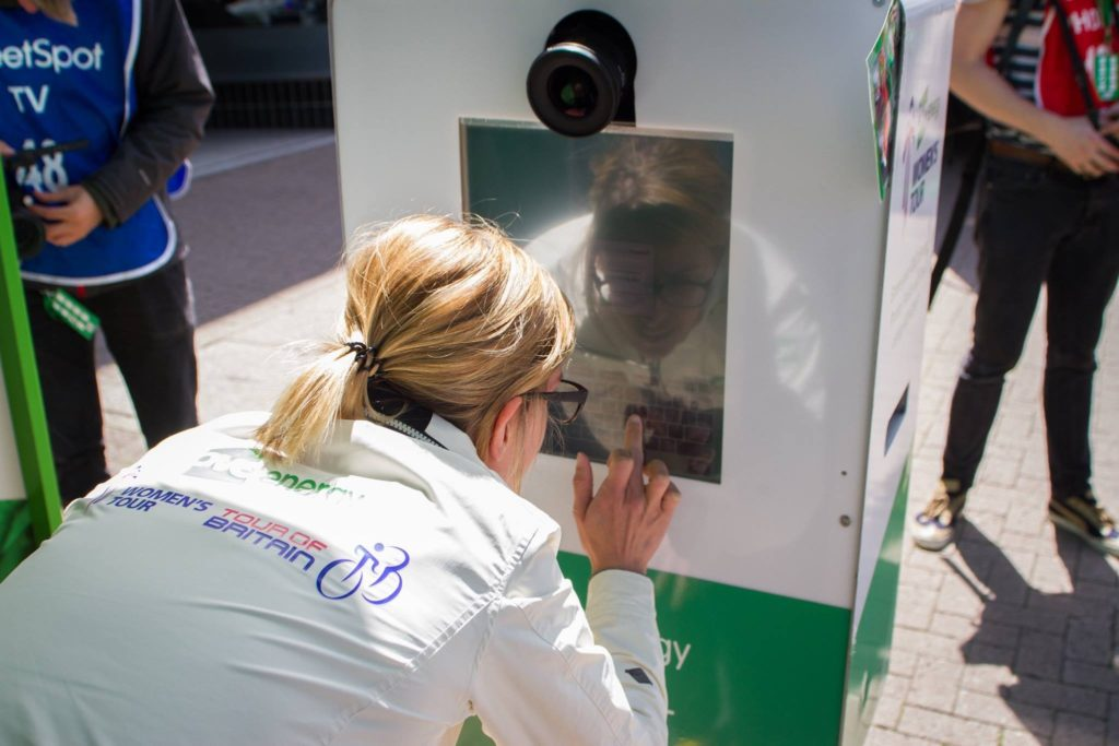 user interacting with green screen pod touchscreen