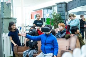 young boy playing with VR headset